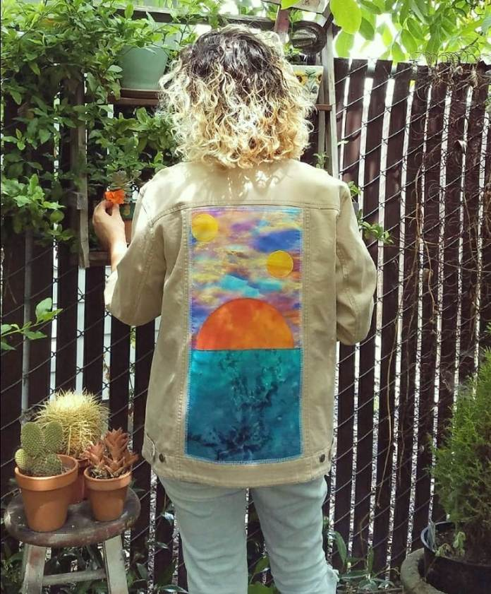Sci-fi Sunset over Teal Water Patchwork Tan Denim Jacket